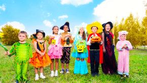 children standing on the grass