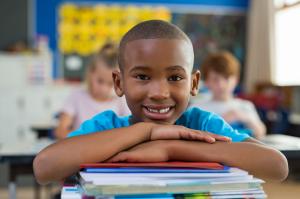 boy smiling inside the school